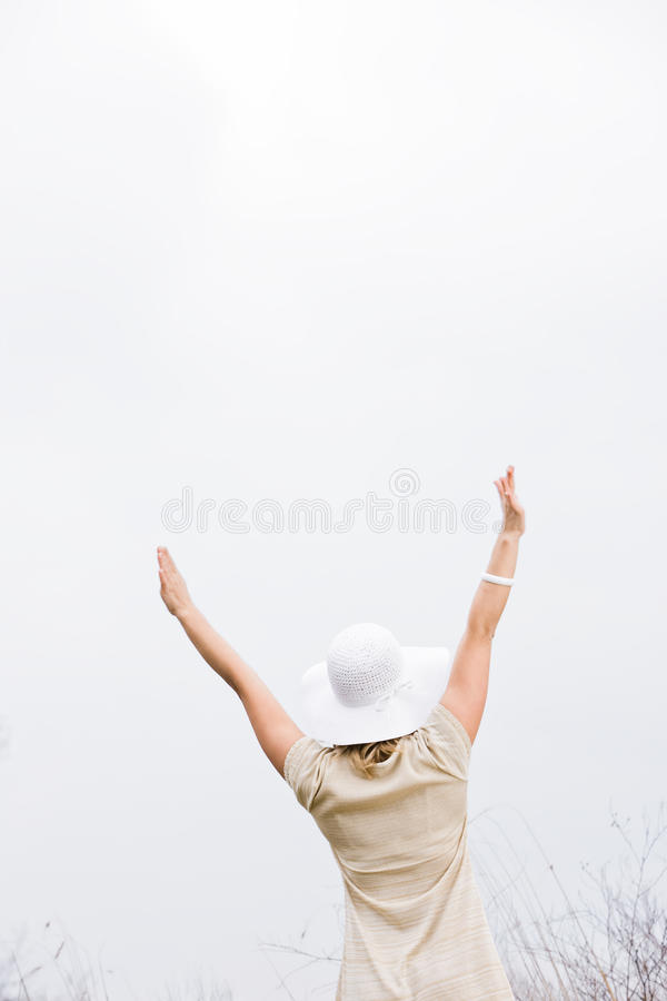 Download Rear View Of Woman With Arms Raised Stock Image - Image: 10516771