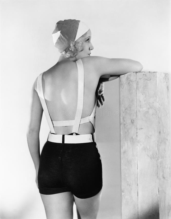 Rear view of woman in bathing suit. (All persons depicted are no longer living and no estate exists. Supplier grants that there will be no model release issues royalty free stock image