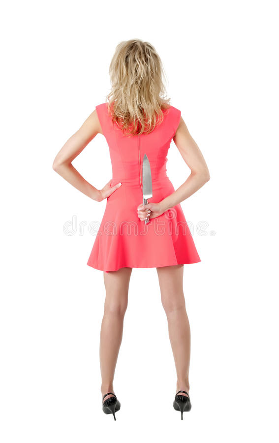 Rear view of woman with knife royalty free stock photo