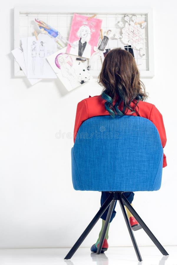 Rear view of woman looking. At mood board royalty free stock image