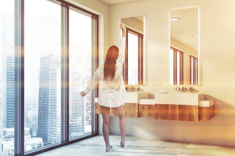Woman in double sink bathroom stock photo