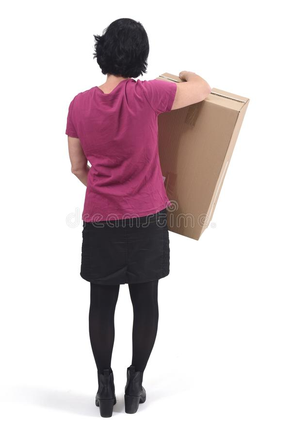 Rear view of  woman with package on white background royalty free stock image