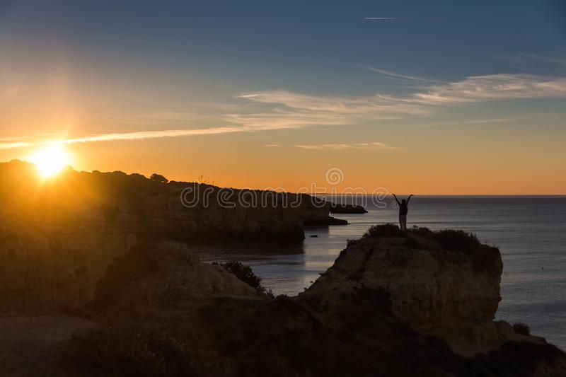 A woman standing on the rock on the Atlantic stock photo