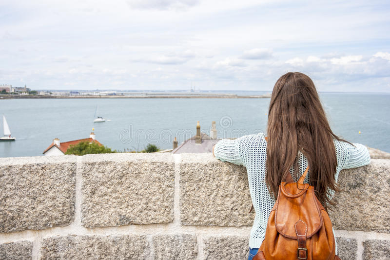 Rear view woman traveling stock image