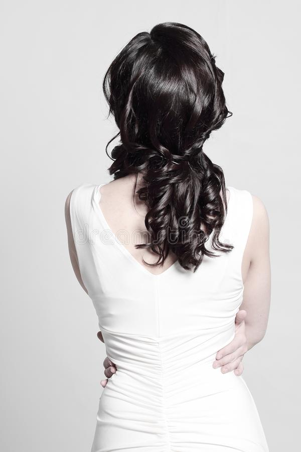 Rear view .woman in white dress .isolated on white. Rear view .woman in white dress .isolated on white royalty free stock photos