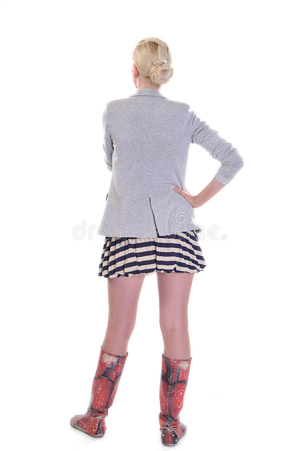 Rear view of young adult woman. Rear view of a casually dressed young adult woman, isolated on white stock photo