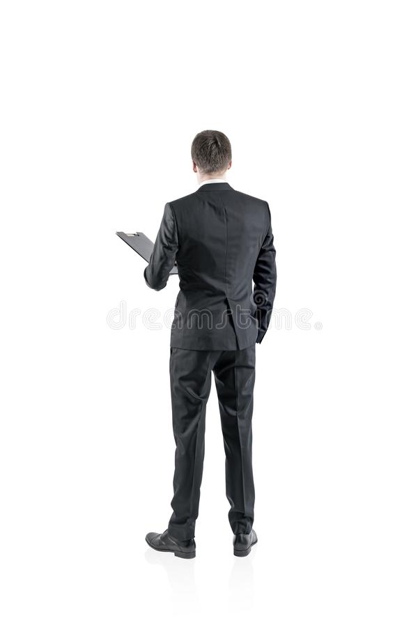 Businessman with a folder, rear view isolate stock image