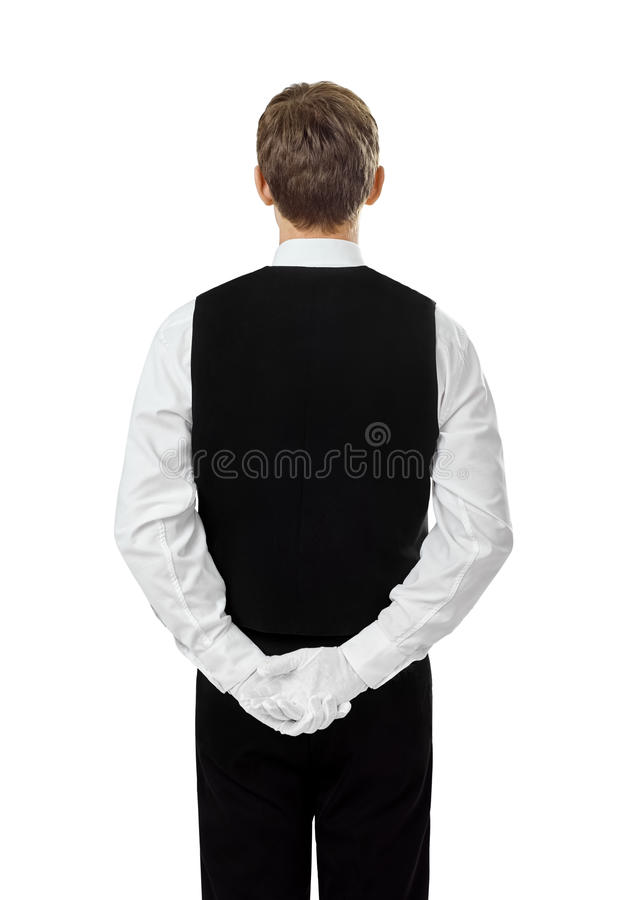 Rear view of young confident waiter stock photos