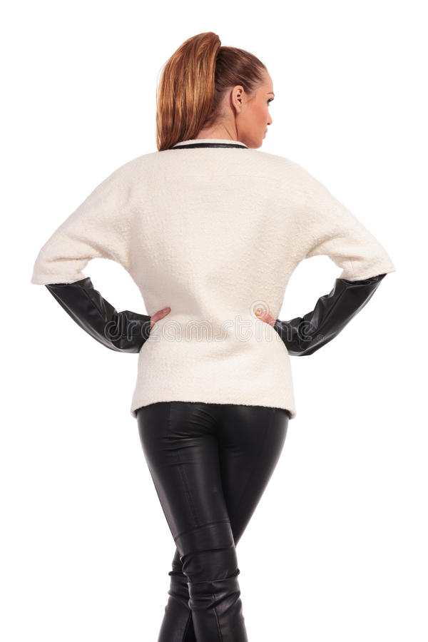 Rear view of a young fashion woman standing stock image