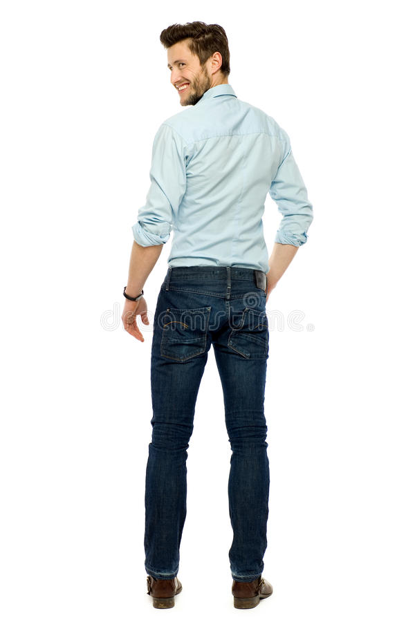 Rear view of young man standing royalty free stock images