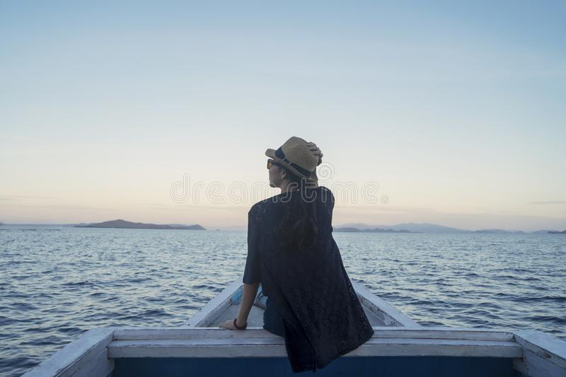 Young woman enjoying beautiful seascape on the boat stock photography