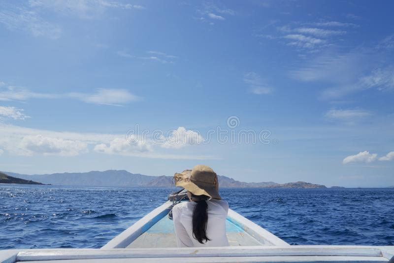 Young woman enjoying seascape on the ship royalty free stock photo