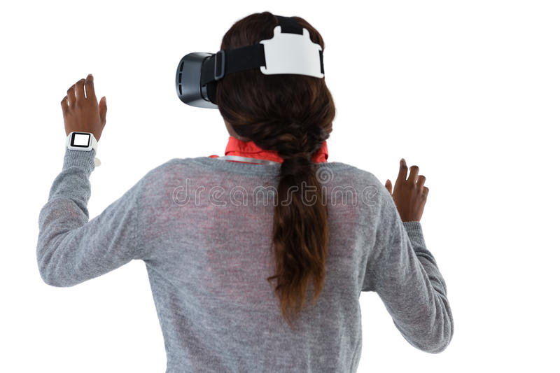 Rear view of young woman gesturing while using vr glasses. Against white background stock images