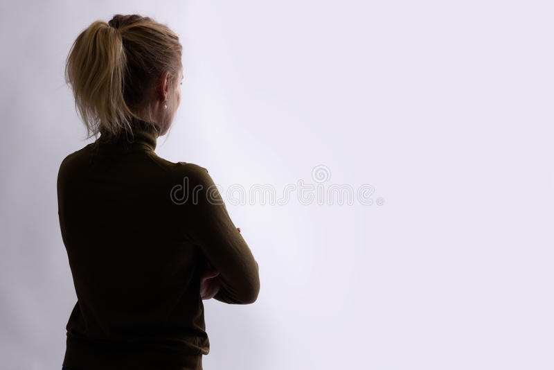Rear view of young woman looking away royalty free stock photos