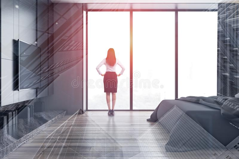 Woman in panoramic bedroom with TV royalty free stock photography