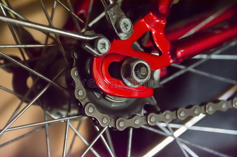 Rear wheel of a bicycle and chain. Abstract background on the theme of sports, bike maintenance, travel outdoors.  royalty free stock image