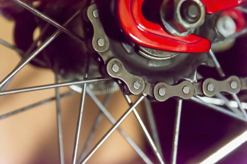 Rear wheel of a bicycle and chain. Abstract background on the theme of sports, bike maintenance, travel outdoors.  stock images