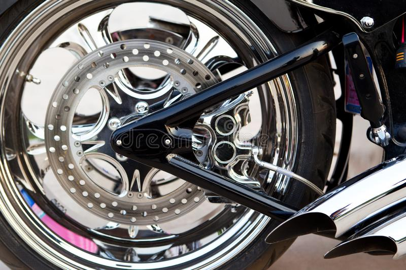 Rear wheel detail of motorcycle with brake pads stock photography