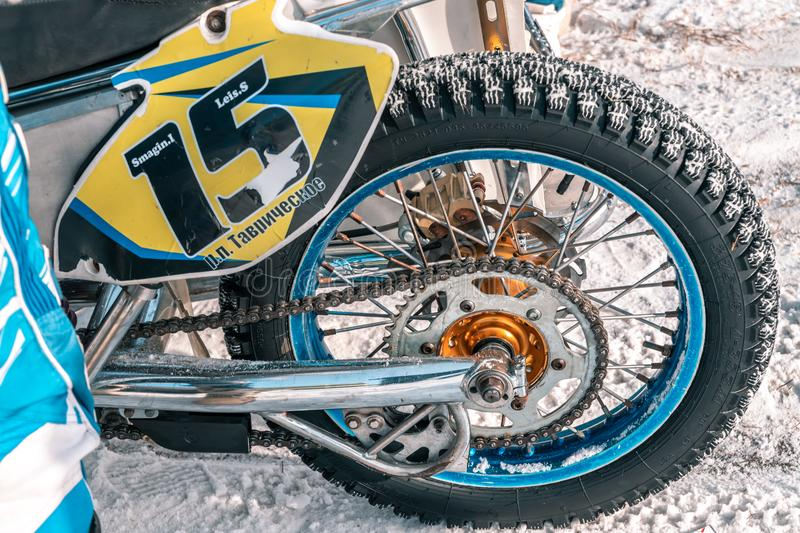 The rear wheel motocross bike. Motocross races in the winter royalty free stock photos