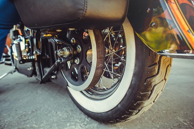 Rear wheel of motorcycle with belt transmission rotation stock photography
