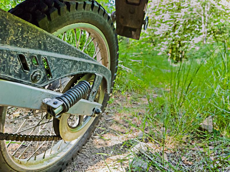 Rear wheel of a motorcycle on a trail royalty free stock images