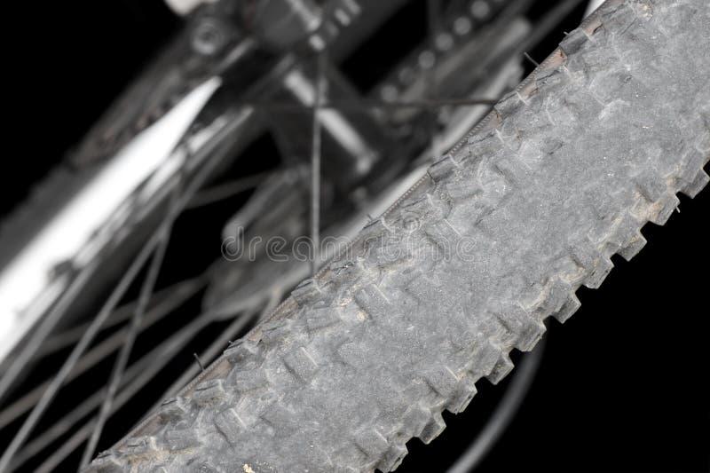 Rear wheel mountain bike. Bald tire on a mountain bike royalty free stock photography