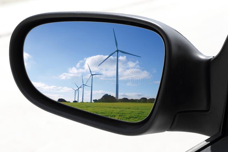 Rearview car driving mirror electric windmills. Rearview car driving mirror view windmills electric aerogenerators stock images