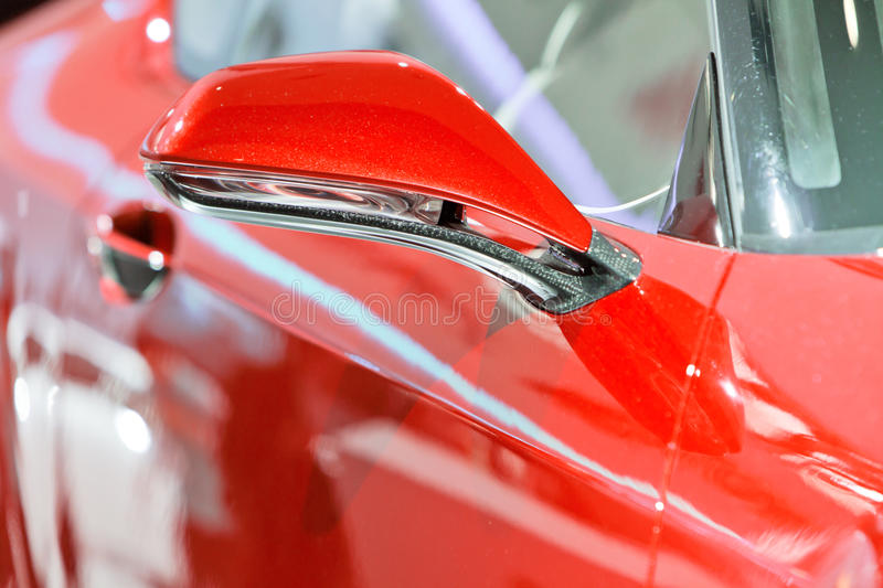The rearview mirror of a red car stock photos
