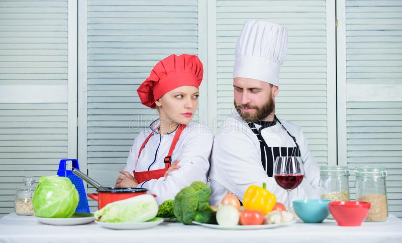 Reasons why couples cooking together. Cooking with your spouse can strengthen relationships. Ultimate cooking challenge. Couple compete in culinary arts. Woman stock photo