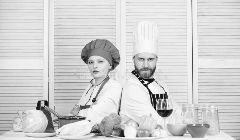 Reasons why couples cooking together. Cooking with your spouse can strengthen relationships. Woman and bearded man royalty free stock image
