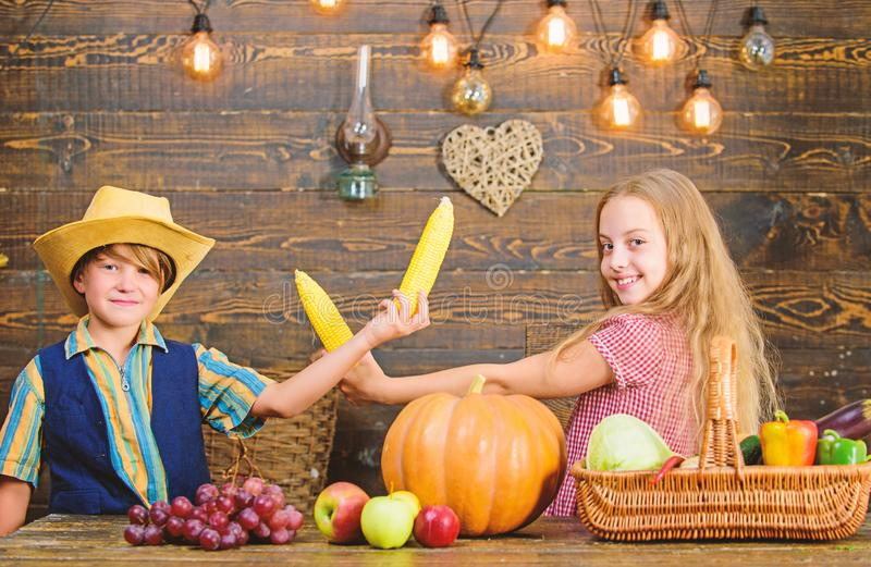 Reasons why every child should experience farming. Held responsible for daily farm chores. Kids farmers girl boy. Vegetables harvest. Children presenting farm royalty free stock image