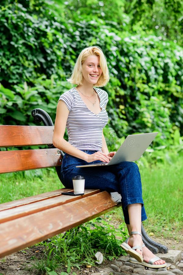 Reasons why you should take your work outside. Power of nature calls. Girl work with laptop in park. Natural environment stock photography