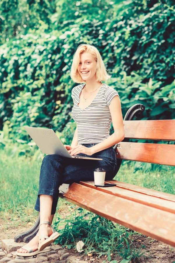 Reasons why you should take your work outside. Power of nature calls. Girl work with laptop in park. Natural environment royalty free stock photo