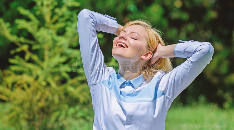 Reasons you should meditate every day. Clear your mind. Find minute to relax. Girl meditate green grass nature royalty free stock photos