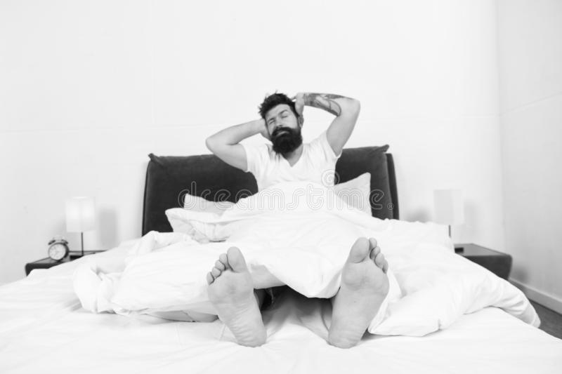 Reasons you are waking up too early. Man bearded hipster woke up too early and feels sleepy and tired. Early to get up. Keep you wide awake in the early stock photography