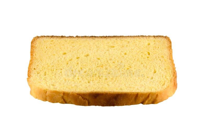 Rebanada cuadrada del pan amarillo de la tostada aislado sobre el fondo blanco, vista lateral foto de archivo libre de regalías