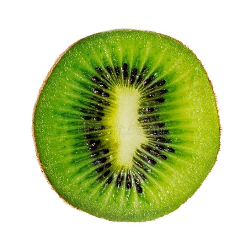 Rebanada de fruta de kiwi aislada en el fondo blanco imagenes de archivo