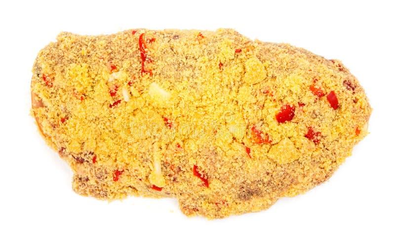Rebanada de la carne de cerdo en migas de pan picantes en blanco imagen de archivo