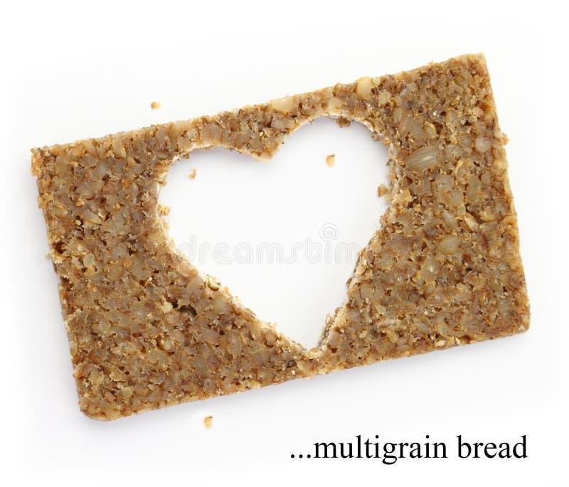 Rebanada de Multigrain de pan con el espacio de la copia en la forma del corazón imagen de archivo