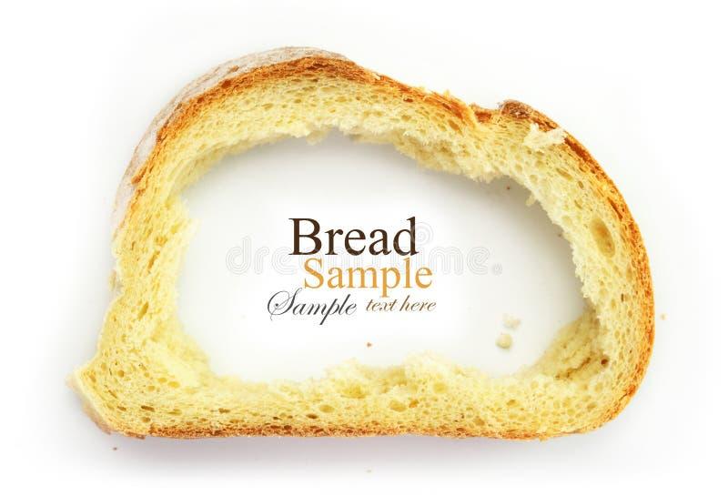 Rebanada de pan blanco con los desaparecidos de centro, corteza como fotografía de archivo