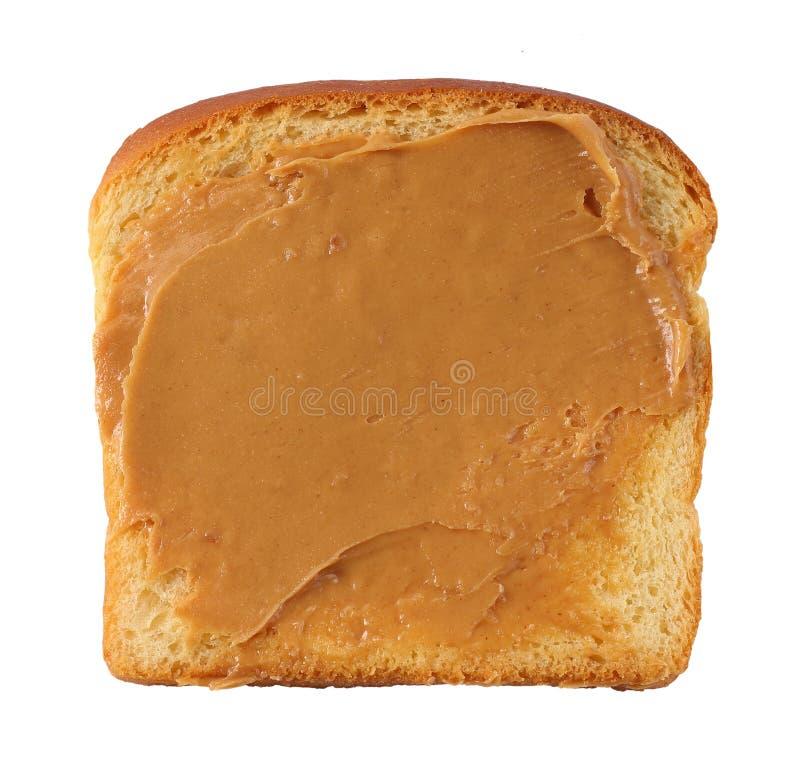 Rebanada de pan con mantequilla de cacahuete foto de archivo