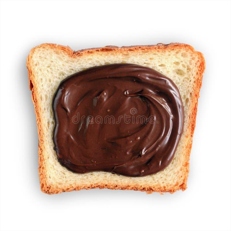 Rebanada de pan con una extensión de la avellana del chocolate fotos de archivo