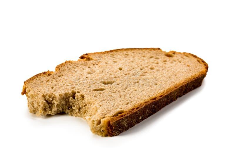 Rebanada de pan mordida en el fondo blanco foto de archivo libre de regalías