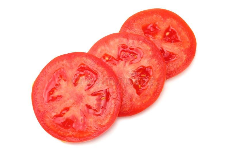 Rebanada de tomate en el fondo blanco Visión superior fotos de archivo