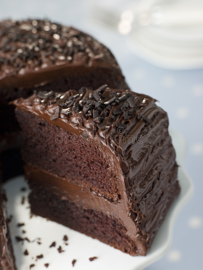 Rebanada de torta del dulce de azúcar de chocolate imagen de archivo
