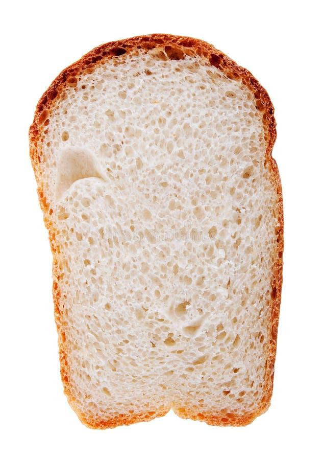 Rebanada del pan aislada en blanco imágenes de archivo libres de regalías