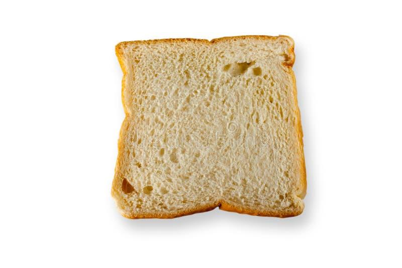 Rebanada del pan aislada en el fondo blanco fotos de archivo