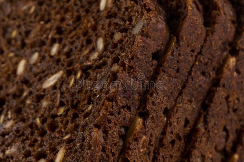 Download Rebanada del pan negro foto de archivo. Imagen de comida - 100529734