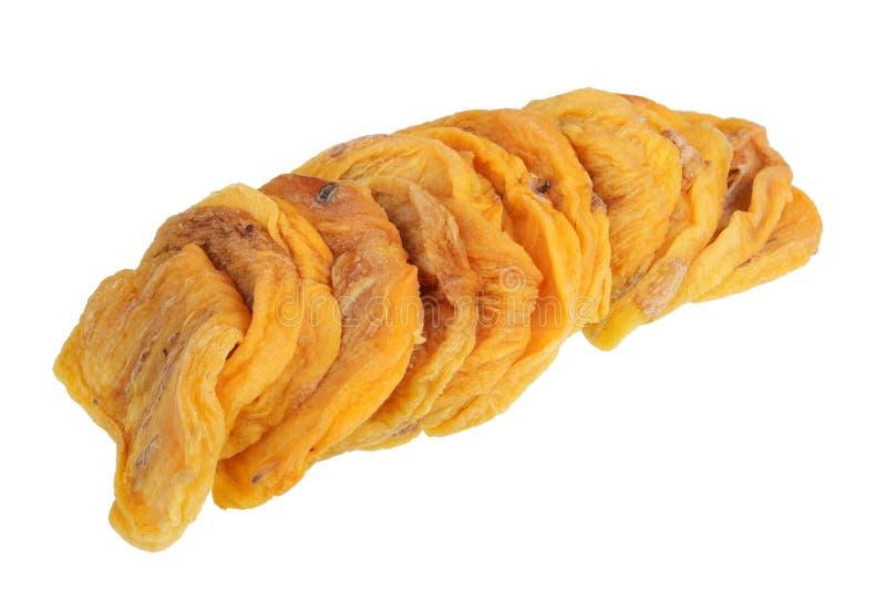 Rebanadas de fruta amarilla secada dulce del caqui aislada imagen de archivo