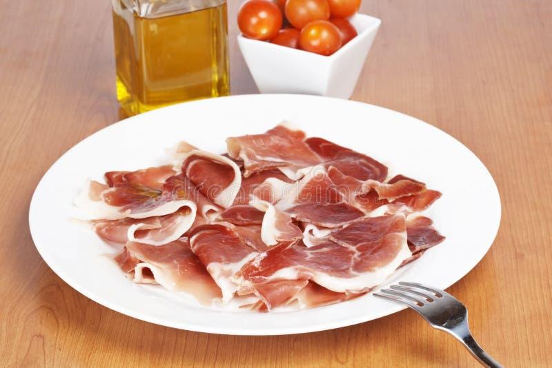 Download Rebanadas de jamón español foto de archivo. Imagen de gastronómico - 7283564